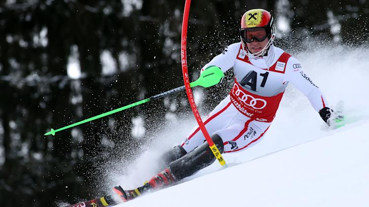 Austria's Marcel Hirscher clears a gate during the first run of an alpine ski, men's World Cup slalom in Kitzbuehel, Austria, Sunday, Jan. 27, 2013. (AP Photo/Alessandro Trovati)