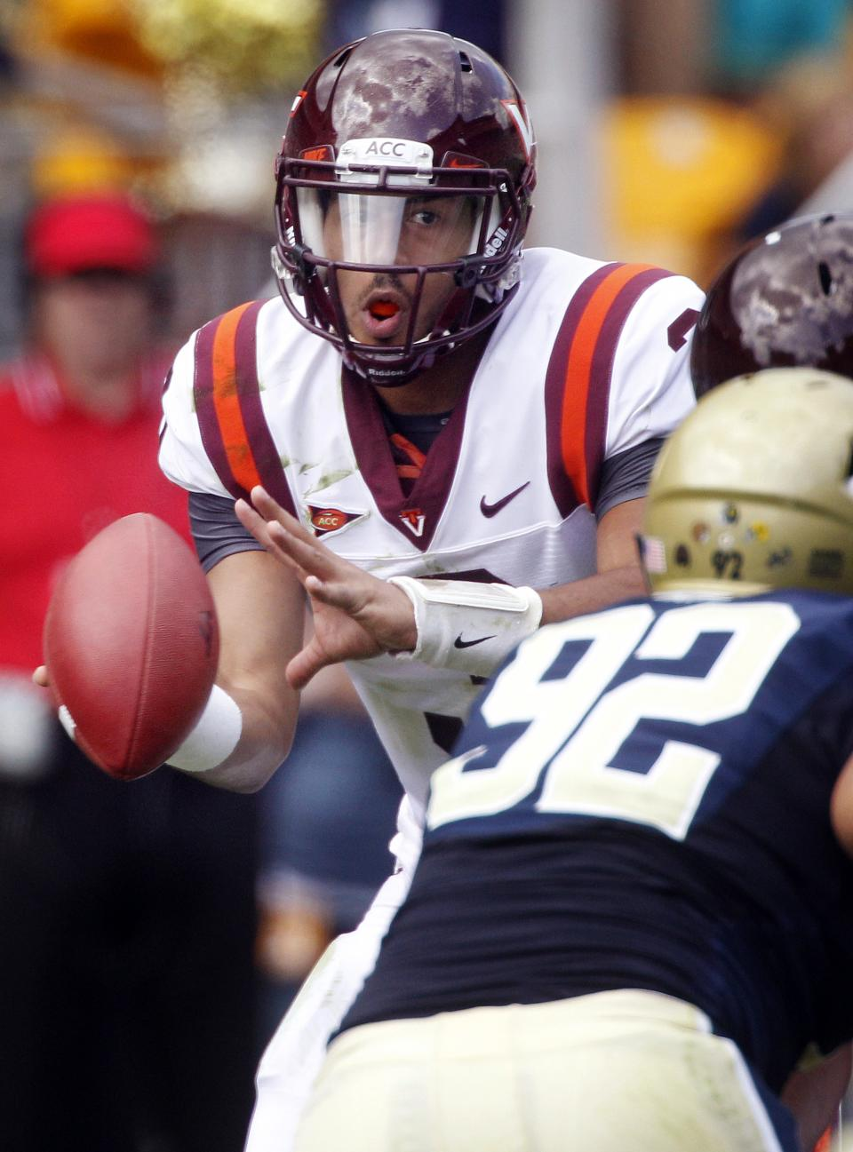 Virginia Tech quarterback Logan Thomas , left, looks to pass as he is pressured by Pittsburgh defensive lineman Bryan Murphy (93) in the second quarter of an NCAA college football game, Saturday, Sept. 15, 2012 in Pittsburgh. (AP Photo/Keith Srakocic)