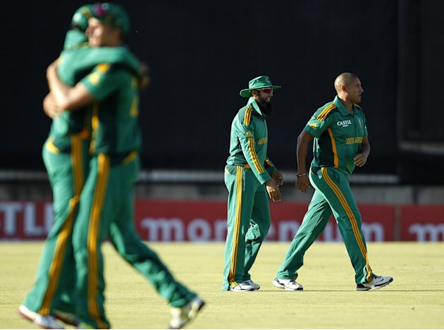 South African players celebrate winning over Pakistan at the end of their ODI cricket match in Bloemfontein