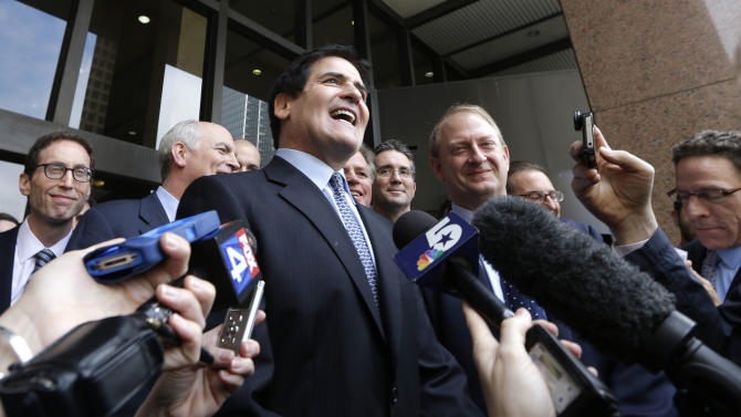 Dallas Mavericks NBA basketball team owner and business man Mark Cuban speaks to the media outside the federal courthouse after he was found not guilty in his insider trading trial in Dallas, Wednesday, Oct. 16, 2013. Jurors say billionaire Mark Cuban did not commit insider-trading when he sold his shares in an Internet company in 2004 after learning of a development that would dilute the value of his investment. The jury in federal court found that the SEC failed to prove several key elements of its case, including that Cuban traded on nonpublic information. (AP Photo/LM Otero)
