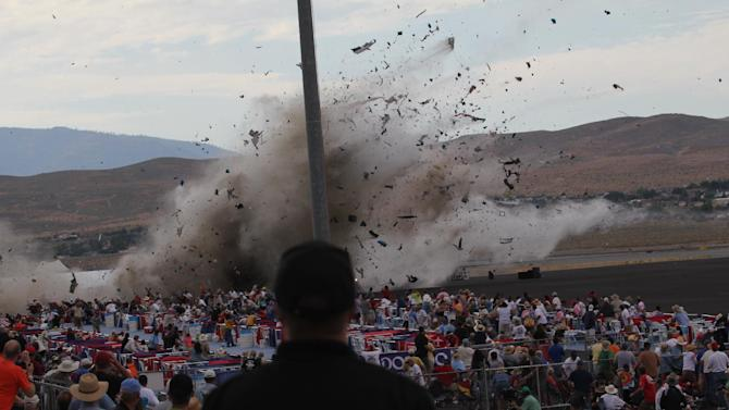 FILE - In this Sept. 16, 2011 file photo, A P-51 Mustang airplane crashes into the edge of the grandstands at the Reno Air show in Reno, Nev. The National Transportation Safety Board releases its safety recommendations Tuesday, April 10, 2012 for the Reno Air Races after last year's horrific crash that left 11 people dead and 70 seriously injured. (AP Photo/Ward Howes, File)
