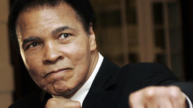 File photo of U.S. boxing great Muhammad Ali posing at the World Economic Forum in Davos