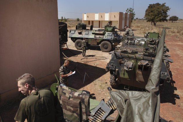 French soldiers refuel Armoured Personnel Carriers that were driven from Ivory Coast, at a Malian air base in Bamako