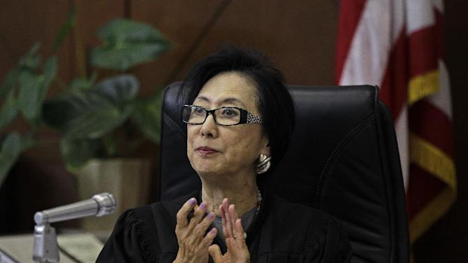 Judge Lillian Sing applauds a defendant on the bench of the Community Court Tuesday, Sept. 18, 2012, in San Francisco. While it's been difficult for researchers to determine cost savings by the courts, new studies suggest the courts are helping stem crime. An evaluation of Washington, D.C.'s community court by the Westat research firm found this summer that defendants who successfully completed diversion programs from 2007 to 2009 were half as likely to reoffend as similar defendants in a traditional court. (AP Photo/Ben Margot)