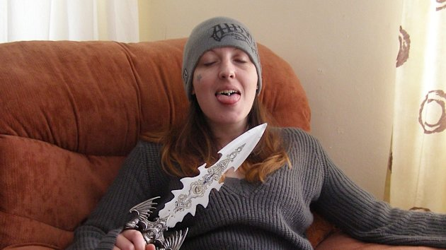 Serial killer Joanna Dennehy smiling and posing with a knife (not used in any of her crimes). It was shown to jurors as evidence at the trial of Gary Richards, also known as Gary Stretch, at Cambridge Crown Court.