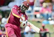 Chris Gayle, pictured on July 1, marked his return to five-day cricket by hitting a half-century on Thursday as West Indies got off to a flying start in reply to New Zealand's 351 all out on the second day of the opening Test here