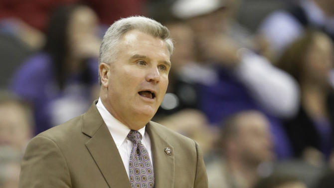 Kansas State head coach Bruce Weber looks to a referee during the first half of an NCAA college basketball game against Texas in the Big 12 tournament on Thursday, March 14, 2013, in Kansas City, Mo. (AP Photo/Orlin Wagner)