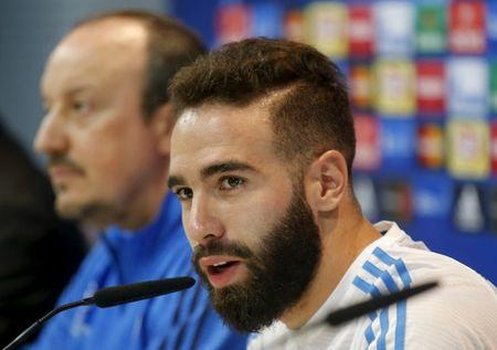 Real Madrid's Daniel Carvajal answers a question next to coach Rafael Benitez during a news conference ahead of their Champions League soccer match against Shakhtar Donetsk at the team's training camp outside Madrid, Spain