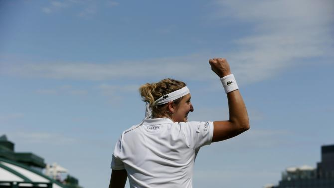 Timea Bacsinszky of Switzerland celebrates after winning her match against Monica Niculescu of Romania at the Wimbledon Tennis Championships in London