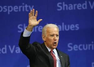 U.S. Vice President Joe Biden waves to the crowd as he leaves after delivering his speech at Yonsei University in Seoul