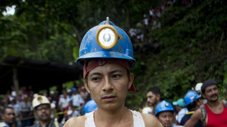 A miner takes a break from the rescue operations at El Comal gold and silver mine after a landslide trapped at least 24 miners inside, in Bonanza, Nicaragua, Friday, Aug. 29, 2014. Rescuers on Friday located 20 of at least 24 gold miners trapped by a landslide in northern Nicaragua, but were not immediately able to bring them to safety. (AP Photo/Esteban Felix)