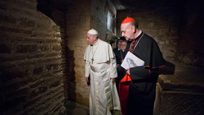 "FILE - In this April 1, 2013 file photo made available by the Vatican newspaper L'Osservatore Romano, Pope Francis, followed by Cardinal Angelo Comastri, right, visits the necropolis where pagans and early Christians were buried under St. Peter's Basilica at the Vatican and where St. Peter is believed to be buried. The Vatican's decision to publicly exhibit the purported relics of the Apostle Peter for the first time this weekend has spotlighted the intense scientific debate over whether the bones actually belong to the first bishop of Rome. No Pope has ever definitively declared the bones to be Peter's, though Pope Paul VI in 1968 said fragments found in the necropolis under St. Peter's Basilica were ""identified in a way that we can consider convincing."" Some Vatican archaeologists disagreed, and debate continues today much as it has over the authenticity of the Shroud of Turin. (AP Photo/L'Osservatore Romano, file, ho)"