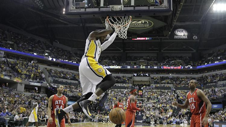 Indiana Pacers' Paul George, top, dunks during the second half of Game 5 in the first round of the NBA basketball playoff series against the Atlanta Hawks, Wednesday, May 1, 2013, in Indianapolis. Indiana defeated Atlanta 106-83. (AP Photo/Darron Cummings)