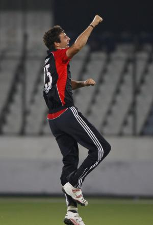 England XI cricketer Steven Finn celebrates wicket of Hyderabad XI's Anwar Ahmed during a practice match in Hyderabad, India, Saturday, Oct. 8, 2011. (AP Photo/Mahesh Kumar A.)