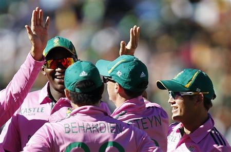South Africa's Lonwabo Tsotsobe looks on as his teammates celebrate the dismissal of Pakistan's Shoaib Malik who was caught out by Rory Kleinveldt during their third One Day International (ODI) cricke