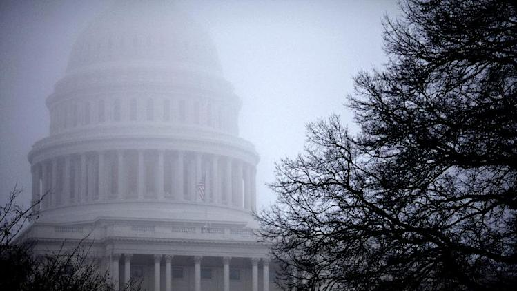 FILE - In this Dec. 10, 2012 file photo, fog obscures the Capitol dome on Capitol Hill in Washington. Big tax increases will hit millions of families and businesses a lot sooner than many realize if Congress and the White House don't agree on a plan to avoid the year-end fiscal cliff of automatic tax increases and government spending cuts. In fact, they already have. More than 70 tax breaks enjoyed by individuals and businesses already expired at the beginning of this year. If Congress doesn't extend them, a typical middle class family could get a $4,000 tax hike when they file their 2012 returns next spring, according to a private analysis. At the same time, businesses could lose dozens of tax breaks they have enjoyed for years. (AP Photo/J. Scott Applewhite)