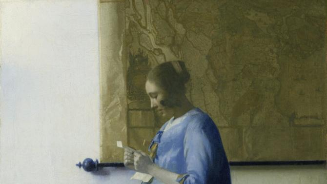 "This image released by the J. Paul Getty Museum shows the 17th century oil painting ""Woman in Blue Reading a Letter"" by Johannes Vermeer. The painting will be on display at the J. Paul Getty Museum in Los Angeles for six weeks beginning Feb. 16. Only about three dozen paintings by the Dutch painter are known to exist, so the Getty exhibit is a rare opportunity for Vermeer fans to see one of his works. The painting is on loan from Amsterdam's Rijksmuseum.  (AP Photo/J. Paul Getty Museum)"