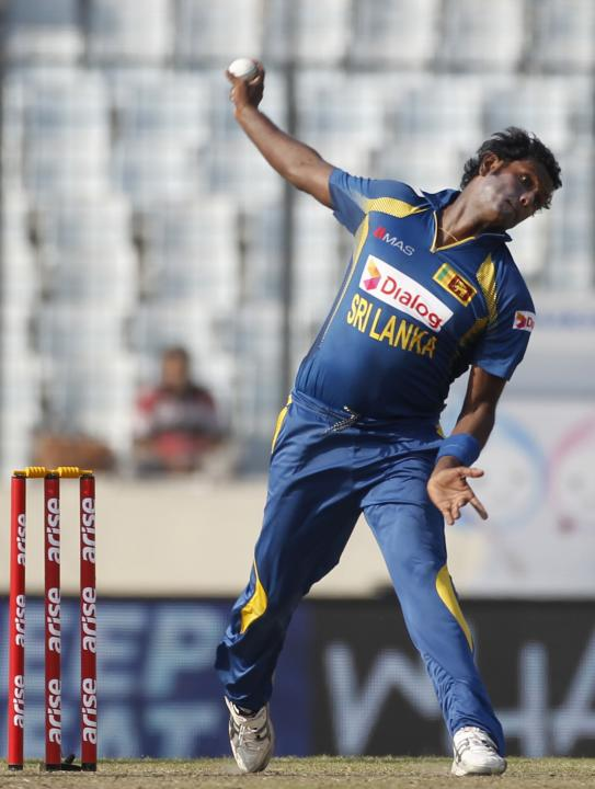 Sri Lanka's captain Angelo Mathews bowls against Pakistan during their 2014 Asia Cup final match in Dhaka