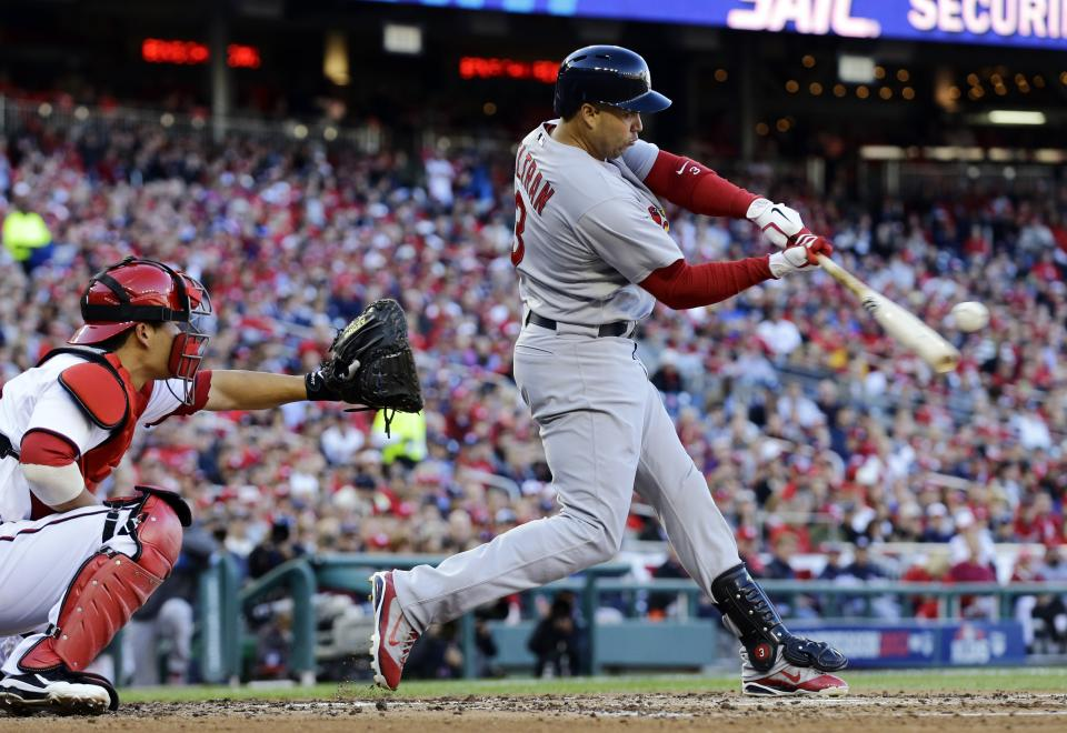 St. Louis Cardinals' Carlos Beltran hits a sacrifice fly in the third inning of Game 4 of the National League division baseball series against the Washington Nationals on Thursday, Oct. 11, 2012, in Washington. The Cardinals' Pete Kozma scored on the play. (AP Photo/Alex Brandon)
