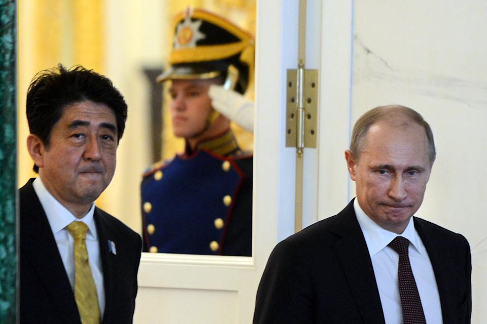 Putin, Japanese leader step up peace treaty effort