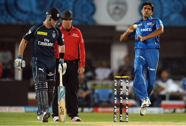 Mumbai Indians  Munaf Patel(R) bowls as Deccan Chargers batsman Daniel Christian watches during the IPL Twenty20  match between Deccan Chargers and Mumbai Indians at Dr. Y.S. Rajasekhara Reddy Cricket