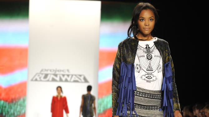 "Fashion by the finalists of  ""The Project Runway"" fashion competition series is modeled during Fashion Week, Friday Feb. 8, 2013, in New York. (AP Photo/Louis Lanzano)"