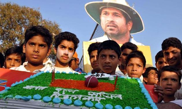 Fans of cricket legend Sachin Tendulkar celebrate as master blaster was conferred Bharat Ratna by President Pranab Mukherjee, in Bhopal on Feb.4, 2014. (Photo: IANS)