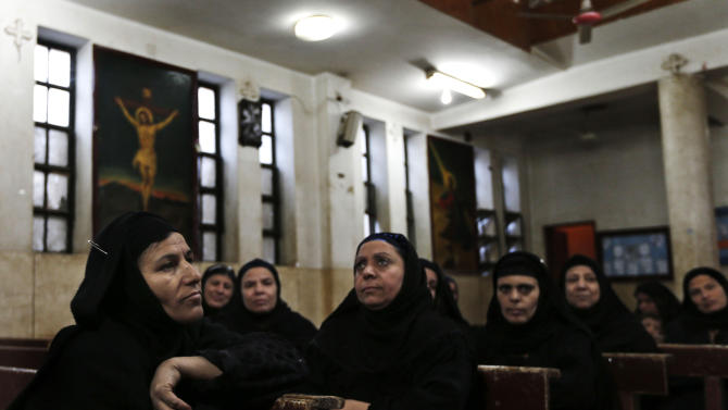 In this Tuesday, Dec. 18, 2012 photo, women attend a class in a church in the village of El-Aziyah near the city of Assiut, southern Egypt.  After a campaign of intimidation by Islamists, most Christians in this southern Egyptian province were too afraid to participate in last week's referendum on an Islamist-drafted constitution they desperately oppose, residents say. Some of the few who dared try to reach polls were pelted by stones. The disenfranchising hikes Christians' worries over their future under Egypt's empowered Islamists, but some young members of the community are starting to push back.(AP Photo/Petr David Josek)