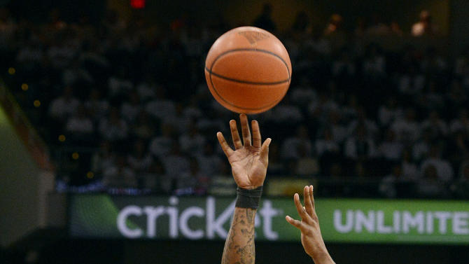 Marquette's Vander Blue, right, shoots over the defense of Louisville's Russ Smith during the first half of their NCAA college basketball game on Sunday, Feb. 3, 2013, in Louisville, Ky. (AP Photo/Timothy D. Easley)