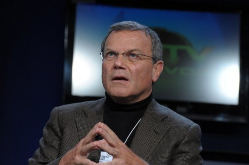 <p>Martin Sorrell, chief executive of British advertising giant WPP, listens during a session at the World Economic Forum in Davos in 2010. WPP on Thursday slashed its revenue forecast for the second time in three months, and warned of a slowdown in Europe and the United States.</p>