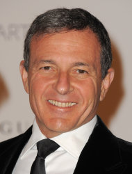 "FILE - In this Nov. 5, 2011 file photo, LACMA trustee Bob Iger arrives at LACMA's Art And Film Gala Honoring Clint Eastwood And John Baldessari at LACMA, in Los Angeles, Calif. Walt Disney Co. CEO Iger says screenwriters Larry Kasdan and Simon Kinberg are both working on standalone ""Star Wars"" movies not part of a new planned trilogy. Iger told CNBC on Tuesday, Feb. 5, 2013, that the standalone movies will be based on ""great 'Star Wars' characters that are not part of the overall saga."" (Photo by Jordan Strauss/Invision/AP Images, File)"