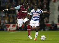 West Ham United's Senegalese player Mohamed Diame (L) vies with Queens Park Rangers' Shaun Wright-Phillips during an English Premier League football match between Queens Park Rangers and West Ham United at Loftus Road in London, England on October 1