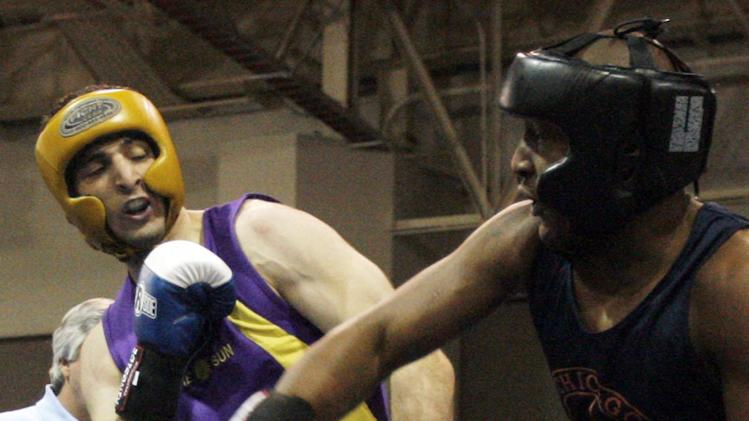 FILE - In this May 4, 2009 file photo,  Tamerlan Tsameav, left,  fights Lamar Fenner of Chicago, in the 201 weight class, during the 2009 Golden Gloves National Boxing Tournament at the Salt Palace, Monday, May 4,  2009. Tsameav was identified as a suspect in the Boston Marathon bombings.  Tsarnaev, who had been known to the FBI as Suspect No. 1 and was seen in surveillance footage in a black baseball cap, was killed overnight Thursday during a getaway attempt, officials said. On Friday, April 19, 2013, thousands of officers were swarming the streets in and around Boston hunting for Tsarnaev's younger brother, Dzhokhar Tsarnaev, 19. (AP Photo/The Salt Lake Tribune, Rick Egan)  DESERET NEWS OUT; LOCAL TV OUT; MAGS OUT