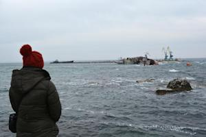 A woman looks at ships on March 8, 2014 which the Ukrainian …
