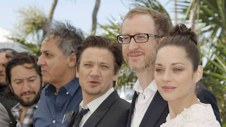 From left, producer Greg Shapiro, director Of photography Darius Khondji, actor Jeremy Renner, director James Gray and actress Marion Cotillard pose for photographers during a photo call for the film The Immigrant at the 66th international film festival, in Cannes, southern France, Friday, May 24, 2013. (AP Photo/Francois Mori)