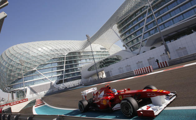 Ferrari driver Fernando Alonso of Spain steers his car during the third free practice at the Yas Marina racetrack , in Abu Dhabi, United Arab Emirates, Saturday, Nov.12, 2011. The Emirates Formula One