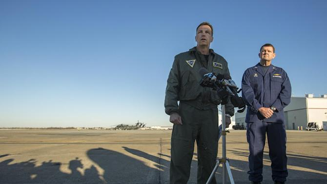 Navy Cmdr. Todd Flannery, left, Cmdr. Helicopter Sea Combat Wing Atlantic, and U.S. Coast Guard Capt. John K. Little, Sector Commander, as they answer questions about a crash of a Navy MH-53-E Sea Dragon helicopter into the Atlantic off Virginia Beach, Wednesday, Jan. 8, 2014, on the tarmac at the Norfolk Naval Station, Va. (AP Photo/The Virginian-Pilot, Bill Tiernan) MAGS OUT.