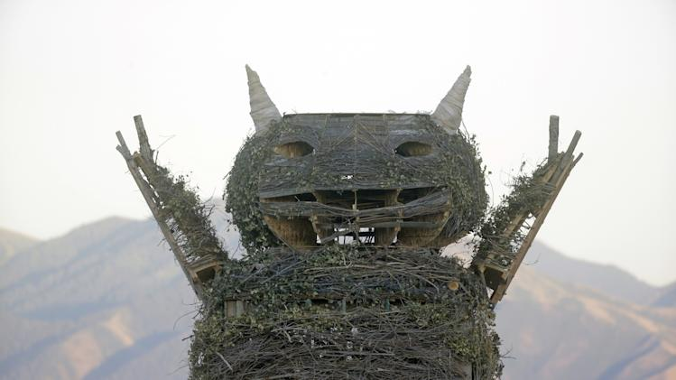 "This Saturday July 12, 2014, photo, shows the upper portion of a giant wooden effigy of a character from the classic children's book, ""Where the Wild Things Are,"" before it was burnt Saturday night, during the Element 11 festival, an event similar to Burning Man, in Grantsville, Utah, about 36 miles southwest of Salt Lake City. Police say Salt Lake City resident Christopher Wallace died after jumping into the burning three-story-tall effigy effigy. (AP Photo/Rick Bowmer)"