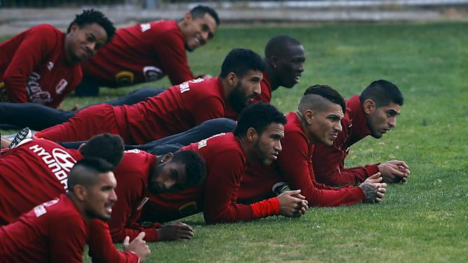 Peru's soccer team players attend a training session in preparation for the Copa America third place match in Santiago