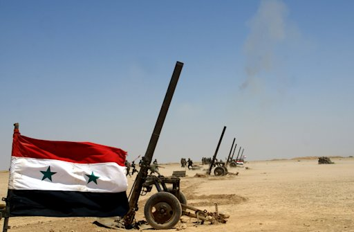 In this Sunday, July 8, 2012 photo released by Syria's official news agency SANA, Syrian troops participate in a live fire exercise in an undisclosed location in Syria.  In a show of force, Syria began large-scale military exercises Sunday to simulate defending the country against outside
