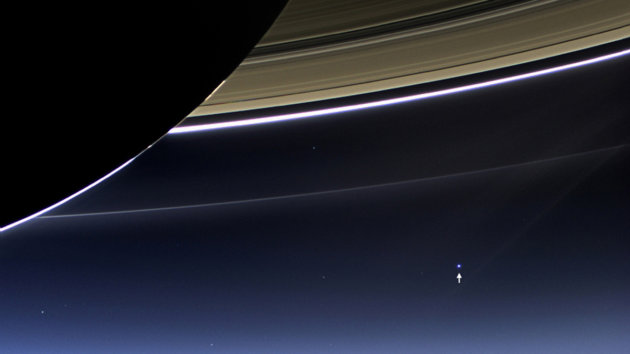 Handout of the wide-angle camera on NASA's Cassini spacecraft capturing Saturn's rings and planet Earth and its moon in the same frame