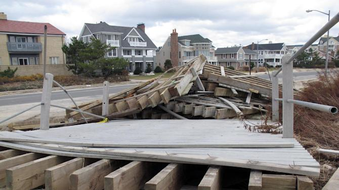 This Nov. 15, 2012 photo shows a section of the Spring Lake N.J. boardwalk that ripped loose during Superstorm Sandy. Spring lake's boardwalk was made of synthetic material. Shore towns are debating whether to use such material, stick with wood, or switch to concrete as they rebuild their boardwalks after the storm. (AP Photo/Wayne Parry)