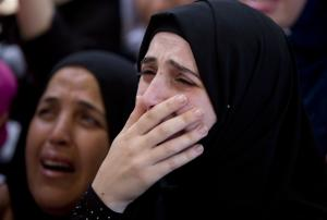 A relative of Palestinian Mohammed Amsha, 25, cries …