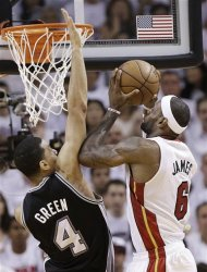 The Miami Heat's LeBron James (6) shoots against the San Antonio Spurs' Danny Green (4) during the first half in Game 7 of the NBA basketball championships, Thursday, June 20, 2013, in Miami. (AP Photo/Lynne Sladky)
