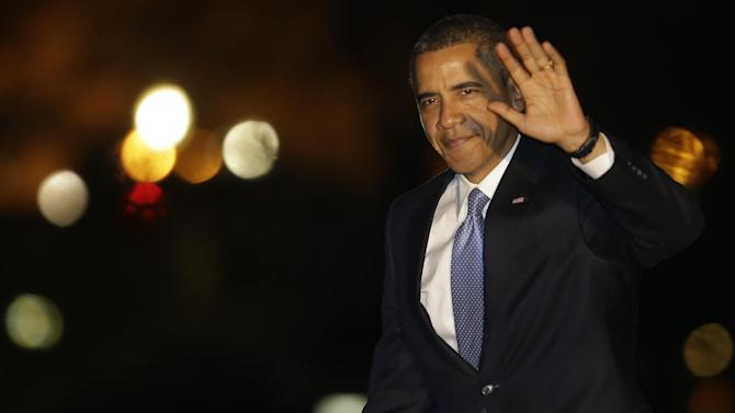 President Barack Obama waves to reporters as he walks on the South Lawn of the White House in Washington, Tuesday, Jan. 29, 2013, as he returns from a trip to Las Vegas where he spoke about immigration. (AP Photo/Charles Dharapak)