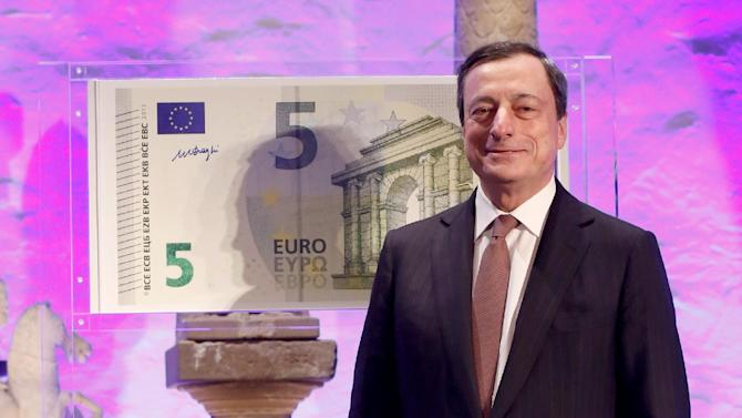 The president of the European Central Bank, ECB,  Mario Draghi, presents the new 5 Euro bill , with  more security features, at the Archeological Museum in Frankfurt, Germany  Thursday Jan. 10, 2013. Earlier the day  the  European Central Bank announced it has left its benchmark interest rate unchanged at a record low of 0.75 percent even though the economy in the euro area remains stuck in recession.  (AP Photo/dapd/Alex Domanski)