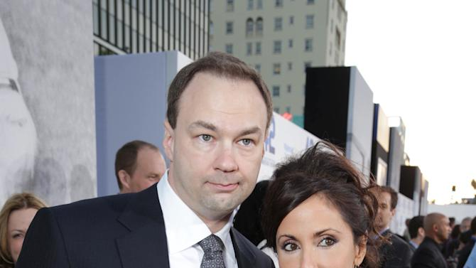 Producer Thomas Tull and wife Alba Tull at The Los Angeles Premiere of Warner Bros. Pictures' and Legendary Pictures' 42, on Tuesday, April, 9th, 2013 in Los Angeles. (Photo by Eric Charbonneau/Invision for Warner Bros./AP Images)