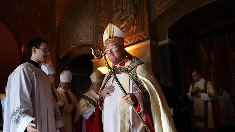 In this photo taken on Saturday, Jan. 26, 2013, Cardinal Timothy Dolan, archbishop of New York, takes part in the recessional for Stan Musial during his funeral at the Cathedral Basilica in St. Louis. Prevailing modern wisdom has been that an American — or a citizen of any superpower — could not be elected pope. Many Vatican watchers still think that's true, but others say that Dolan, a Ballwin native, may represent the first real prospect of an American pontificate. (AP Photo/St. Louis Post-Dispatch, Robert Cohen)  EDWARDSVILLE INTELLIGENCER OUT; THE ALTON TELEGRAPH OUT