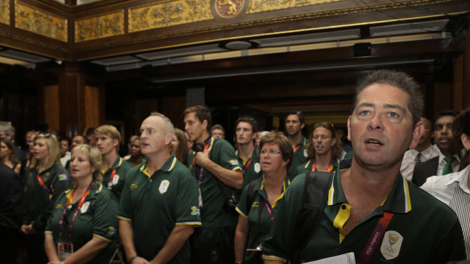 Members of the South Africa Olympic team attend an event at the South Africa House in central London, ahead of the 2012 Summer Olympics, Thursday, July 26, 2012. (AP Photo/Lefteris Pitarakis)