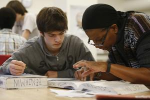 Student James Montalbano, 11th grade, works with teacher…